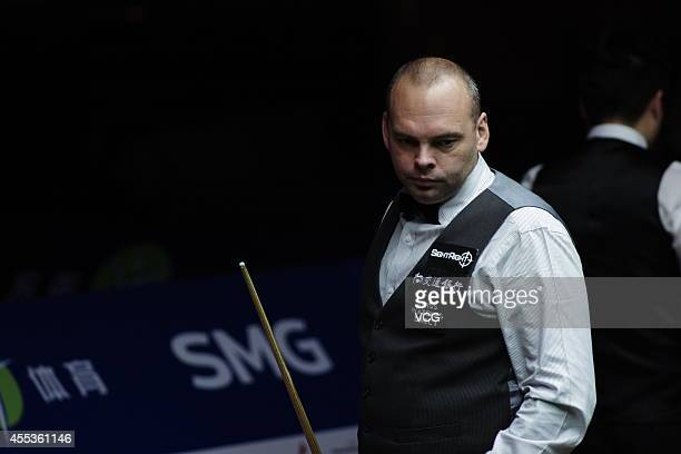 Stuart Bingham of England reacts against Ding Junhui of China during day six of the World Snooker Bank of Communications OTO Shanghai Masters 2014 at...