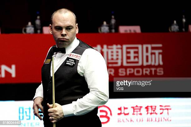 Stuart Bingham of England reacts during the first round match against Sam Baird of England on day two of China Open at Beijing University Students'...