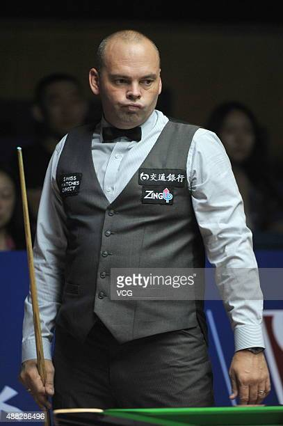 Stuart Bingham of England reacts in the match against Fang Xiongman of China during day two of the Shanghai Masters 2015 at Shanghai Grand Stage on...