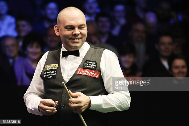 Stuart Bingham of England reacts in the semifinal match against Joe Perry of England on day five of the Ladbrokes World Grand Prix at Venue Cymru on...