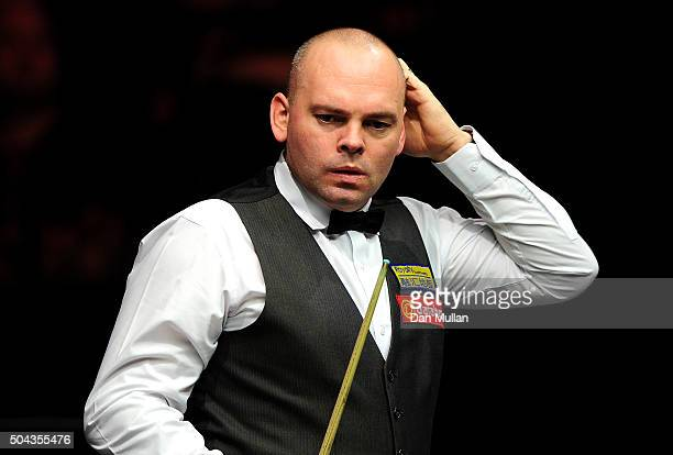Stuart Bingham of England reacts whilst playing against Ding Junhui of China during Day One of the Dafabet Masters at Alexandra Palace on January 10...