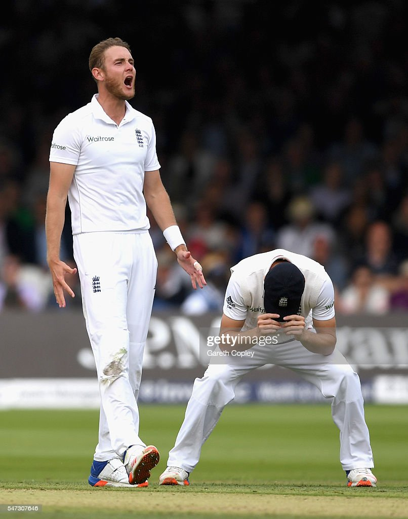 Stuart Broad and Chris Woakes of England react during the 1st Investec Test between England and Pakistan at Lord's Cricket Ground on July 14, 2016 in London, England.