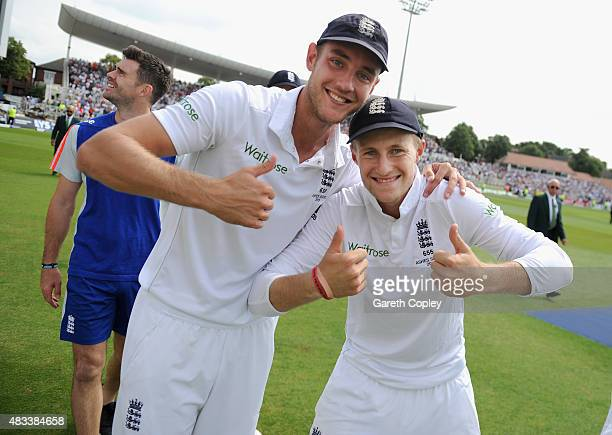 Stuart Broad and Joe Root of England celebrate after winning the 4th Investec Ashes Test match between England and Australia at Trent Bridge on...