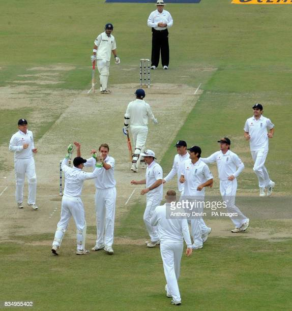 Stuart Broad celebrates getting Virender Sehwag caught by Matt Prior for 0 during the first day of the second test at the Punjab Cricket Association...