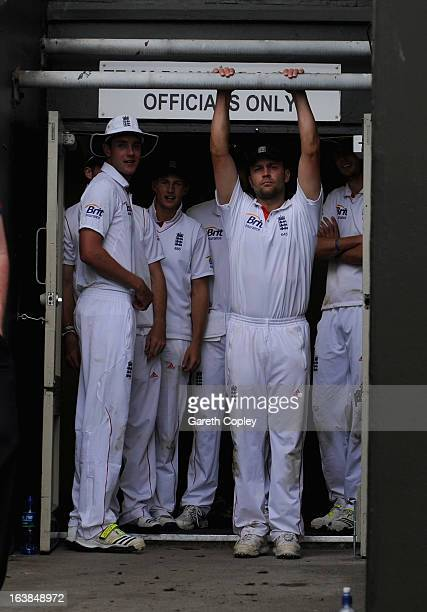 Stuart Broad Joe Root and Jonathan Trott of England wait for the rain to stop during day four of the second Test match between New Zealand and...