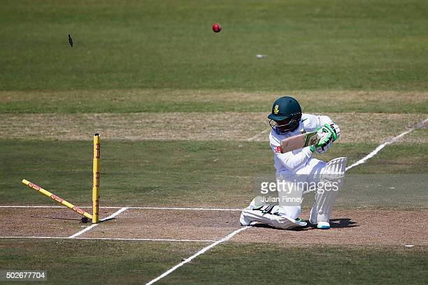 Stuart Broad of England bowls out Temba Bavuma of South Africa during day three of the 1st Test between South Africa and England at Sahara Stadium...