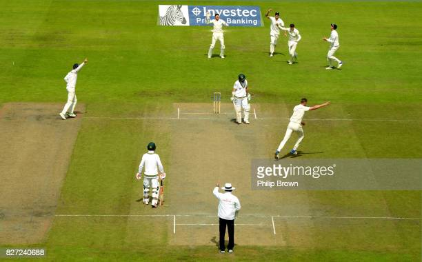 Stuart Broad of England celebrates after dismissing Dean Elgar of South Africa during the fourth day of the 4th Investec Test match between England...