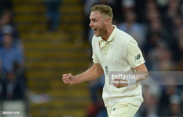 Stuart Broad of England celebrates after dismissing Roston Chase of the West Indies during the third day of the 1st Investec Test match between...