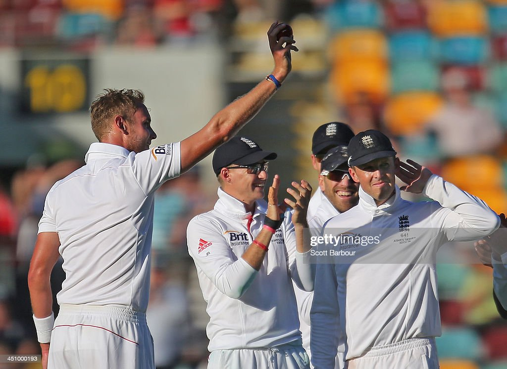 Stuart Broad of England celebrates after taking his fifth wicket after dismissing Mitchell Johnson of Australia as Graeme Swann gestures to the crowd during day one of the First Ashes Test match between Australia and England at The Gabba on November 21, 2013 in Brisbane, Australia.