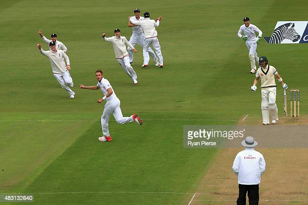 Stuart Broad of England celebrates after taking the wicket of Michael Clarke of Australia during day one of the 4th Investec Ashes Test match between...