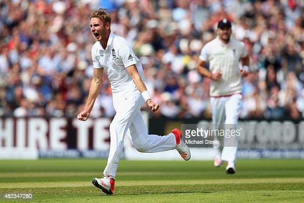 Stuart Broad of England celebrates capturing the wicket of Chris Rogers of Australia during day two of the 3rd Investec Ashes Test match between...
