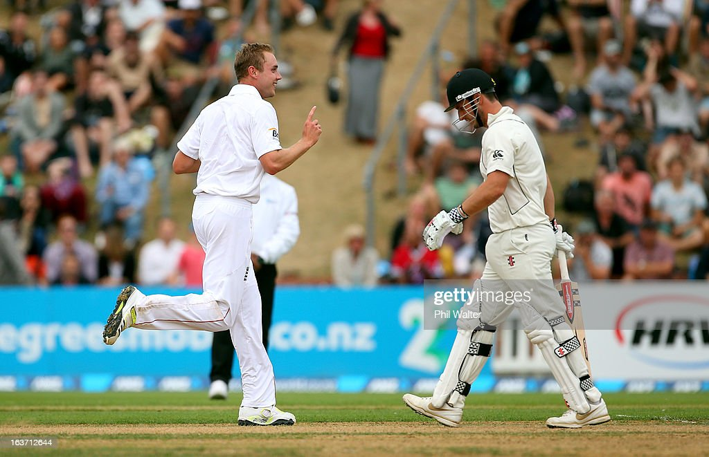 Stuart Broad of England celebrates his wicket of Hamish Rutherford of New Zealand during day two of the second Test match between New Zealand and...