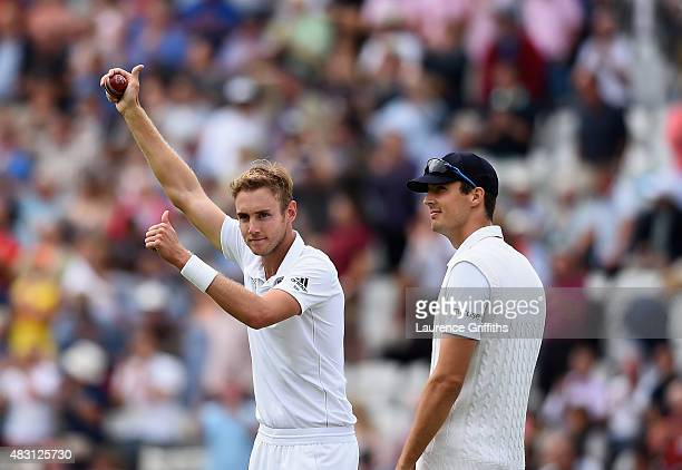 Stuart Broad of England celebrates taking his fifth wicket that of Michael Clarke of Australia alongside Steven Finn during day one of the 4th...