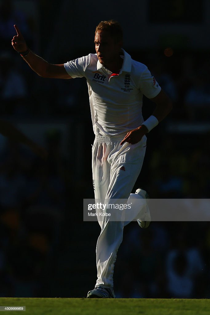 Stuart Broad of England celebrates taking the wicket of Mitchell Johnson of Australia during day one of the First Ashes Test match between Australia and England at The Gabba on November 21, 2013 in Brisbane, Australia.