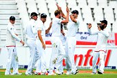 Stuart Broad of England celebrates the wicket of AB de Villiers of the Proteas with his team mates during day 3 of the 3rd Test match between South...