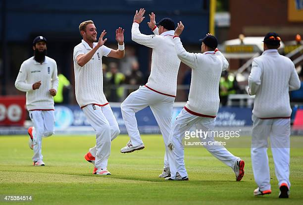 Stuart Broad of England celebrates the wicket of Kane Williamson of New Zealand during day three of the 2nd Investec Test Match between England and...