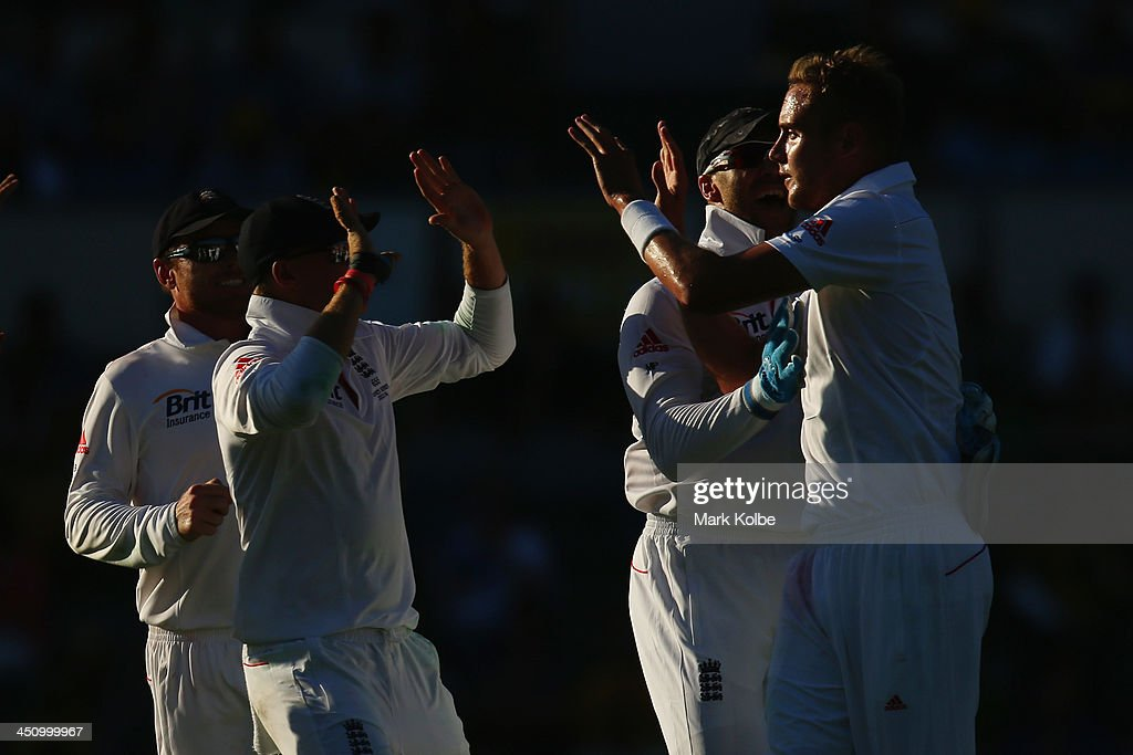 Stuart Broad of England celebrates with his team mates after taking the wicket of Mitchell Johnson of Australia during day one of the First Ashes Test match between Australia and England at The Gabba on November 21, 2013 in Brisbane, Australia.