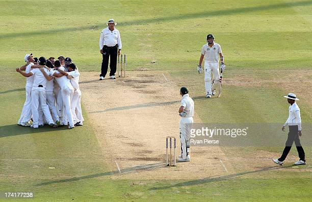 Stuart Broad of England celebrates with his teammates after Graeme Swann of England took the final wicket to claim victory during day four of the 2nd...