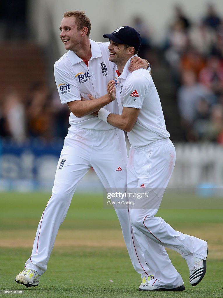 Stuart Broad of England celebrates with James Anderson after dismissing Hamish Rutherford of New Zealand during day two of the second Test match between New Zealand and England at Basin Reserve on March 15, 2013 in Wellington, New Zealand.