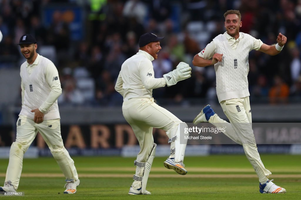 Stuart Broad (R) of England celebrates with Jonny Bairstow after capturing the wicket of Jason Holder during day three of the 1st Investec Test match between England and West Indies at Edgbaston on August 19, 2017 in Birmingham, England.