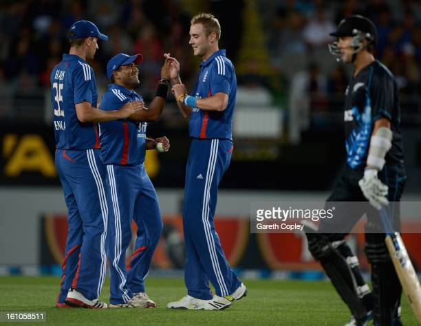 Stuart Broad of England celebrates with Samit Patel and Alex Hales after dismissing Trent Boult of New Zealand during the 1st T20 International...