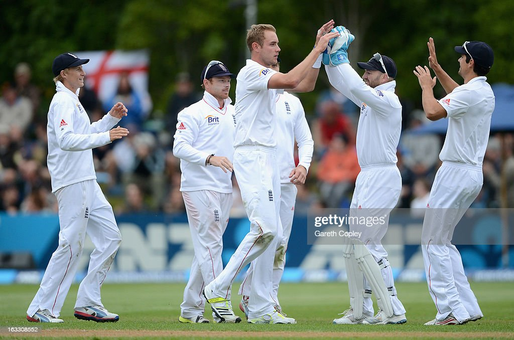 Stuart Broad of England celebrates with teammates after dismissing BJ Watling of New Zealand during day three of the First Test match between New Zealand and England at University Oval on March 8, 2013 in Dunedin, New Zealand.