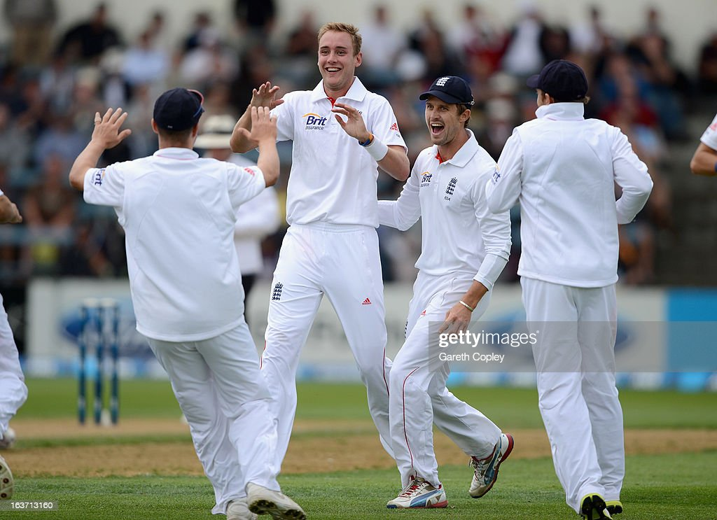 Stuart Broad of England celebrates with teammates after dismissing Ross Taylor of New Zealand during day two of the second Test match between New Zealand and England at Basin Reserve on March 15, 2013 in Wellington, New Zealand.