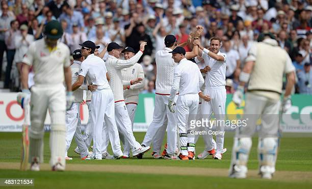 Stuart Broad of England celebrates with teammates after dismissing Shaun Marsh of Australia during day one of the 4th Investec Ashes Test match...