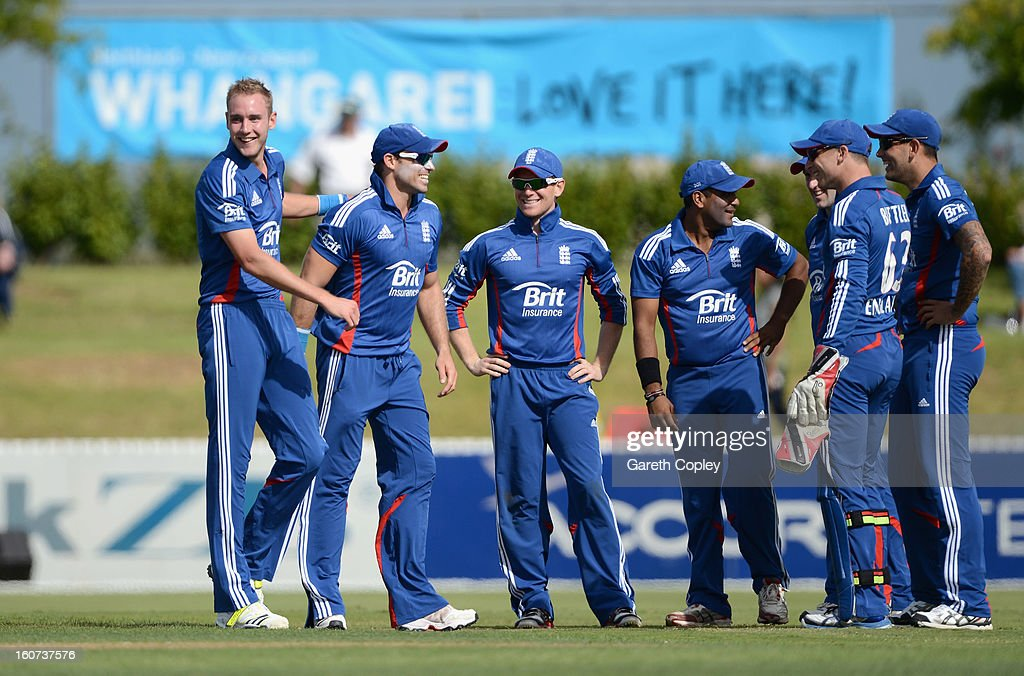 Stuart Broad of England celebrates with teammates after taking a hat trick during a T20 Practice Match between New Zealand XI and England at Cobham Oval on February 5, 2013 in Whangarei, New Zealand.