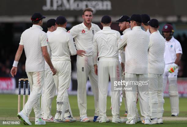 Stuart Broad of England celebrates with teammates after taking the wicket of Kyle Hope of West Indies during day two of the 3rd Investec Test match...