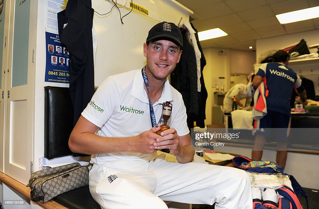 Stuart Broad of England celebrates with the ashes urn in the dressing rooms after the 5th Investec Ashes Test match between England and Australia at The Kia Oval on August 23, 2015 in London, United Kingdom.