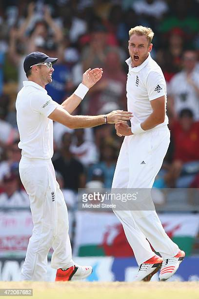 Stuart Broad of England clebrates with James Anderson after taking the wicket of Marlon Samuels of West Indies during day three of the 3rd Test match...