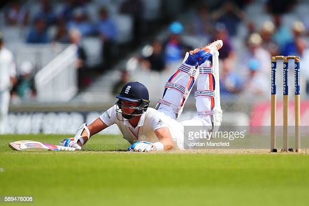 Stuart Broad of England dives to make his ground during day four of the 4th Investec Test between England and Pakistan at The Kia Oval on August 14...