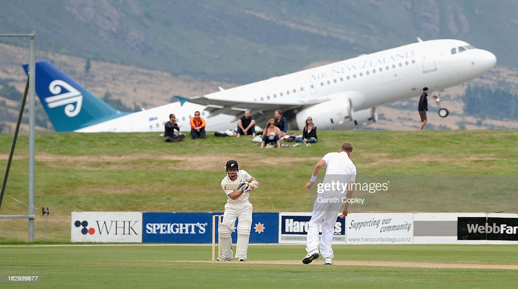 Stuart Broad of England fields a shot from BJ Watling of a New Zealand XI during day four of the International Tour Match between the New Zealand XI...