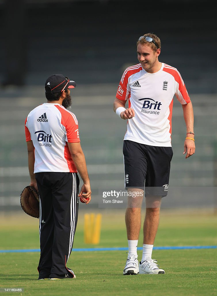 Stuart Broad of England has a chat with spin bowling coach Mushtaq Ahmed during the England nets session at the R Premadasa Stadium on March 12 2012...