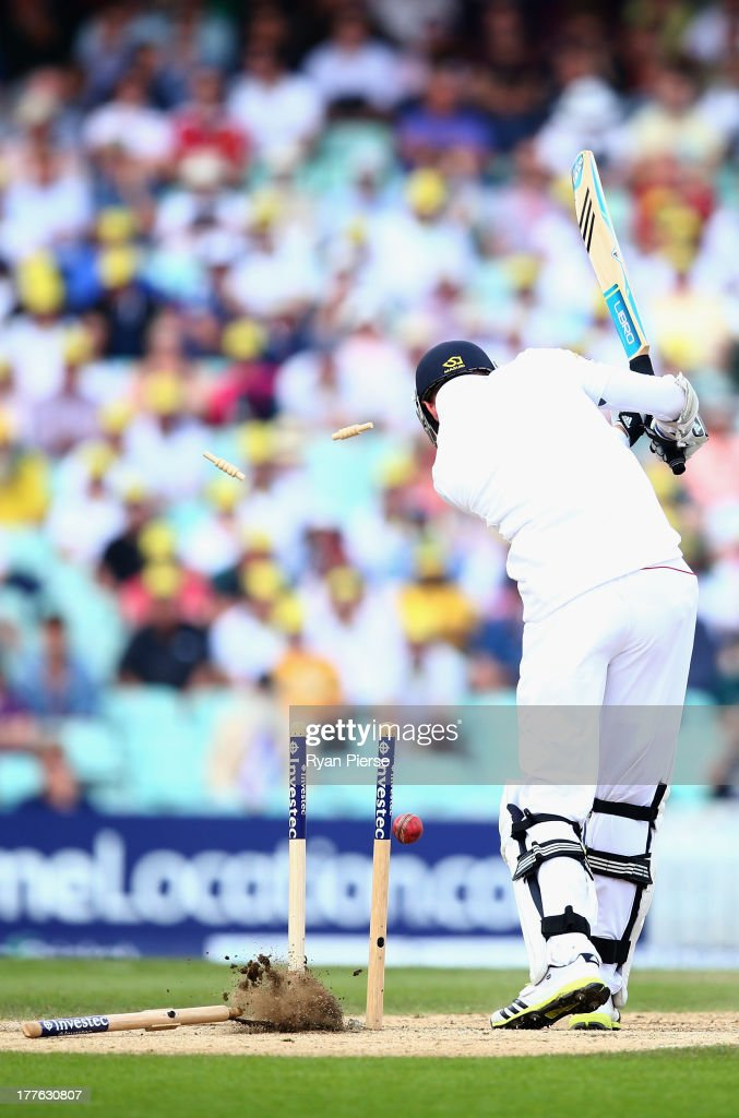 <a gi-track='captionPersonalityLinkClicked' href=/galleries/search?phrase=Stuart+Broad&family=editorial&specificpeople=574360 ng-click='$event.stopPropagation()'>Stuart Broad</a> of England is bowled by Mitchell Starc of Australia during day five of the 5th Investec Ashes Test match between England and Australia at the Kia Oval on August 25, 2013 in London, England.