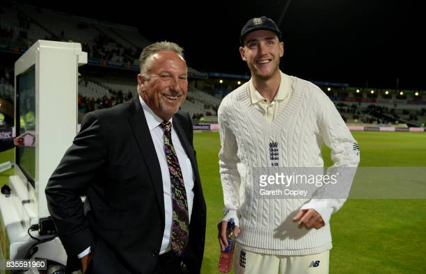 Stuart Broad of England is congratulated by Sir Ian Botham after becoming England's second leading wickettaker during day three of the 1st Investec...