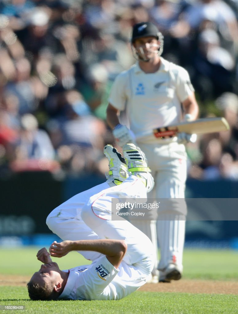Stuart Broad of England lies on the ground after falling while bowling during day two of the First Test match between New Zealand and England at University Oval on March 7, 2013 in Dunedin, New Zealand.