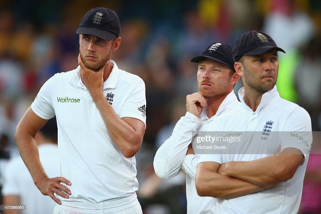Stuart Broad (L) of England looks on at the after match presentations alongside Ian Bell (C) and Jonathan Trott (R) as the series was squared 1-1 after West Indies won the match by five wickets during day three of the 3rd Test match between West Indies and England at Kensington Oval on May 3, 2015 in Bridgetown, Barbados.