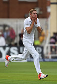 Stuart Broad of England looks on in disbelief at Ben Stokes after his amazing catch to dismiss Adam Voges of Australia during day one of the 4th...
