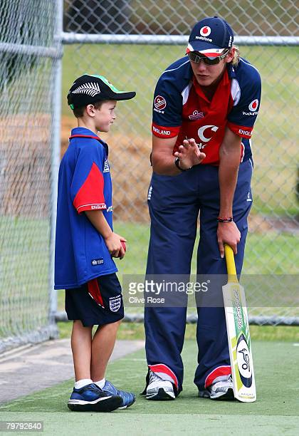 Stuart Broad of England passes on some bowling tips during a coaching clinic for local children at Sacred Heart College on February 16 2008 in...