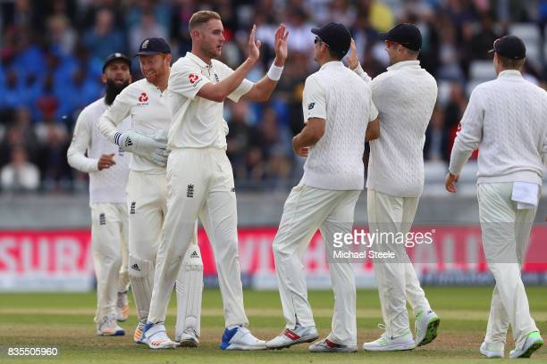 Stuart Broad of England receives the plaudits after bowling Kemar Roach of West Indies during day three of the 1st Investec Test match between...