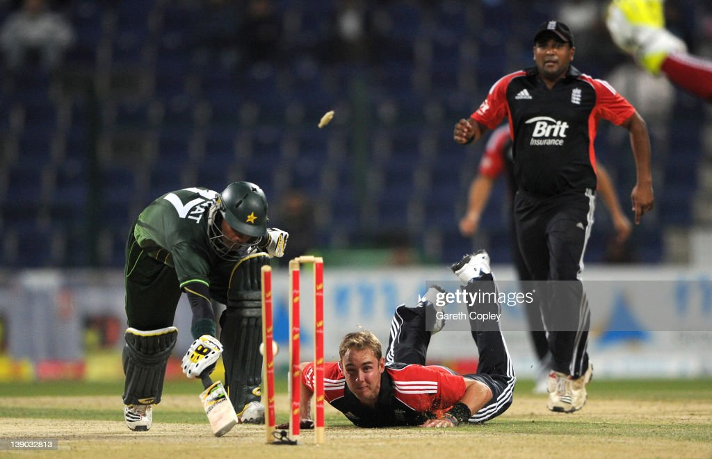 Stuart Broad of England runs out Imran Farhat of Pakistan during the 2nd One Day International between Pakistan and England at Sheikh Zayed Stadium on February 15, 2012 in Abu Dhabi, United Arab Emirates.