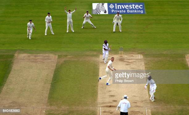 Stuart Broad of England runs out Kyle Hope of the West Indies during the fifth day of the 2nd Investec Test match between England and the West Indies...