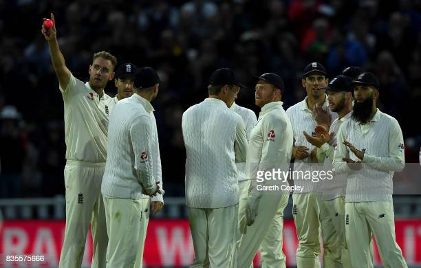 Stuart Broad of England salutes Sir Ian Botham after becoming England's second leading wickettaker during day three of the 1st Investec Test between...