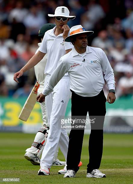 Stuart Broad of England talks with Umpire Aleem Dar after Mark Wood has the wicket of Chris Rogers of Australia demmed a noball during day two of the...