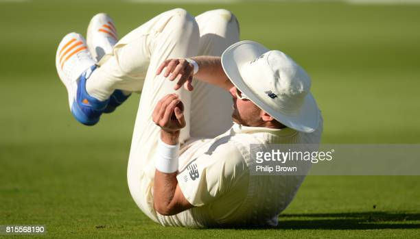 Stuart Broad of England tumbles after catching Keshav Maharaj of South Africa during the third day of the 2nd Investec Test match between England and...