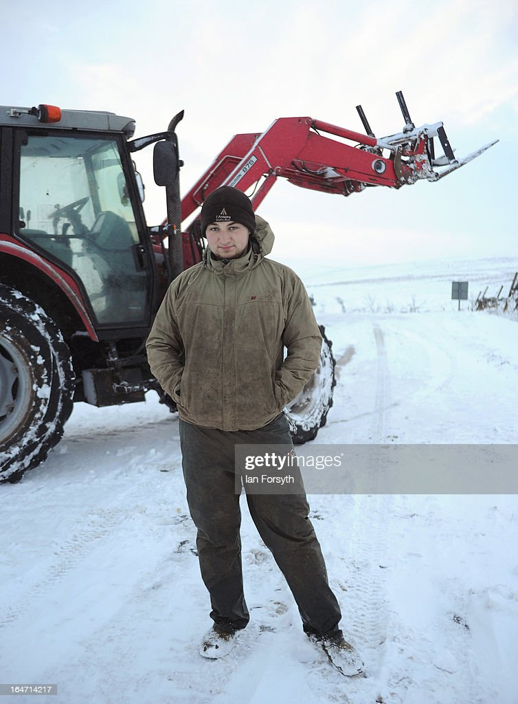 Stuart Buckle, 23, stands in front of a tractor at his farm in the hamlet of Barras during heavy snow on March 27, 2013 near Kirkby Stephen, Cumbria, England. Stuart, 23, runs Bleathgill Farm with his father Wilf and as heavy snow continues to fall, extra effort is needed to look after and protect their Swaledale sheep from the cold. Across the UK, farmers are battling to save livestock after heavy snow and freezing temperatures has left thousands of sheep and cattle stuck in the fields with no access to food and fresh water.