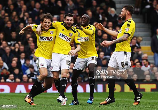 Stuart Dallas of Brentford celebates with team mates after opening the scoring during the Sky Bet Championship match between Fulham and Brentford at...