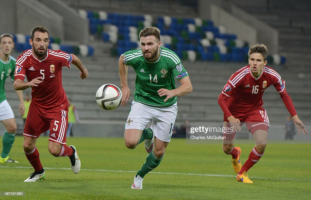Stuart Dallas (2nd L) of Northern Ireland and Attila Fiola (L) and Adam Nagy (R) of Hungary during the Euro 2016 Group F qualifying match at Windsor Park on September 7, 2015 in Belfast, Northern Ireland.